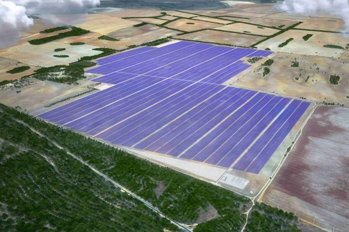 Aerial view of a large solar farm on rural land