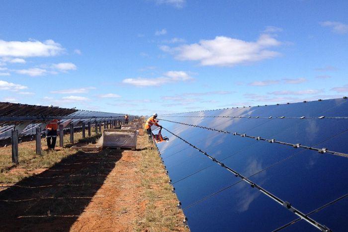 A man installs a solar farm