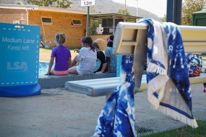 Kids splash in the local Murrurundi pool.